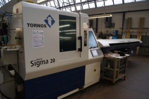 Drehmaschine + Stangenlader TORNOS Deco Sigma 20